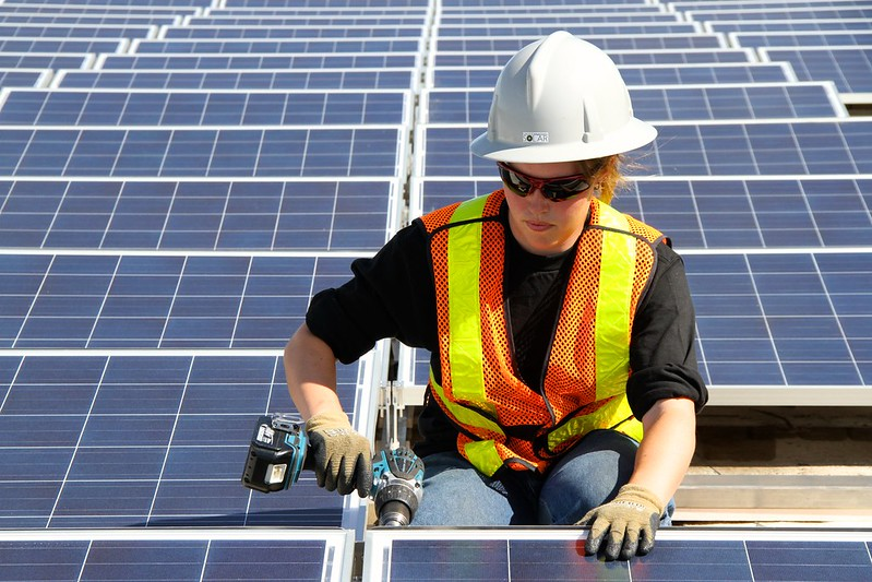 A Canadian worker installing PV modules. Source: Green Energy Futures, David Dodge, Flickr