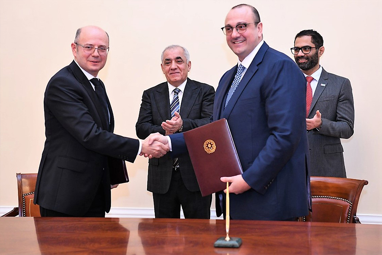 Azerbaijan's Energy Ministry Parviz Shahbazov (left) and Masdar's Mohammed Jameel Al Ramahi (second right) hail the deal at the signing ceremony (Image credit: Masdar)