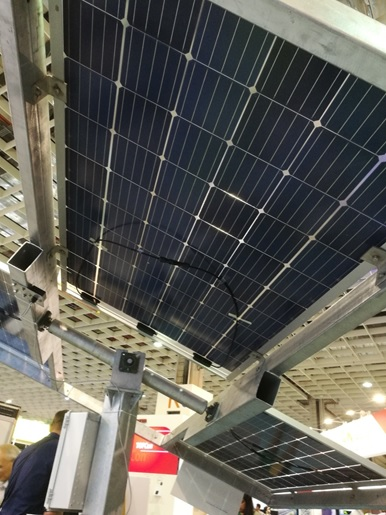 Big Sun's iPVTracker complete with bifacial modules, shown on the Big Sun booth at the 2018 Energy Taiwan event in Taipei on 19 September 2018, as pictured from below. Mounting height, tracking design and how to use the area underneath the mounted bifacial modules are set to be the key factors for bankability of bifacial modules in 2019. Image: PV Tech