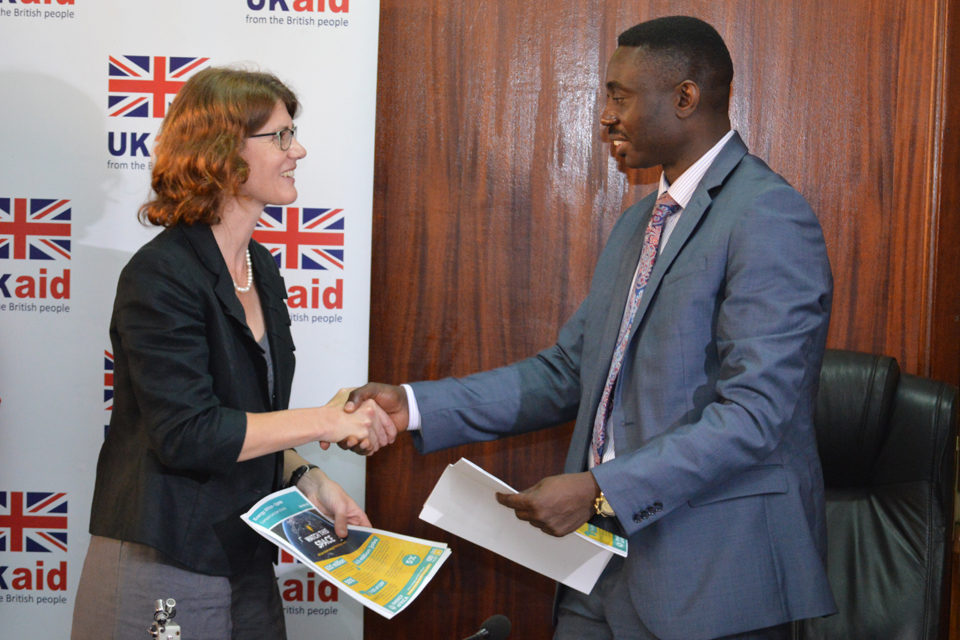 Head of DFID Uganda, Jennie Barugh and Dr Stephen Isabalija, Permanent Secretary at the Ugandan Ministry for Energy and Mineral Development exchange signed copies of the Energy Africa Compact last December. Credit: DFID