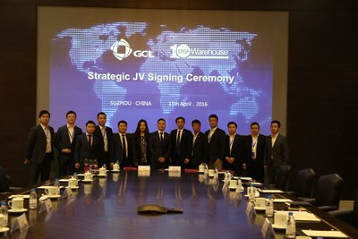 The two companies sign the agreement for GCL SI's acquisition. Image: GCL SI.