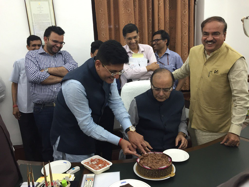 Energy minister Piyush Goyal and finance minister Arun Jaitley cut the cake in celebration of the GST tax Bill passing. Credit: Lakshman Roy on Twitter