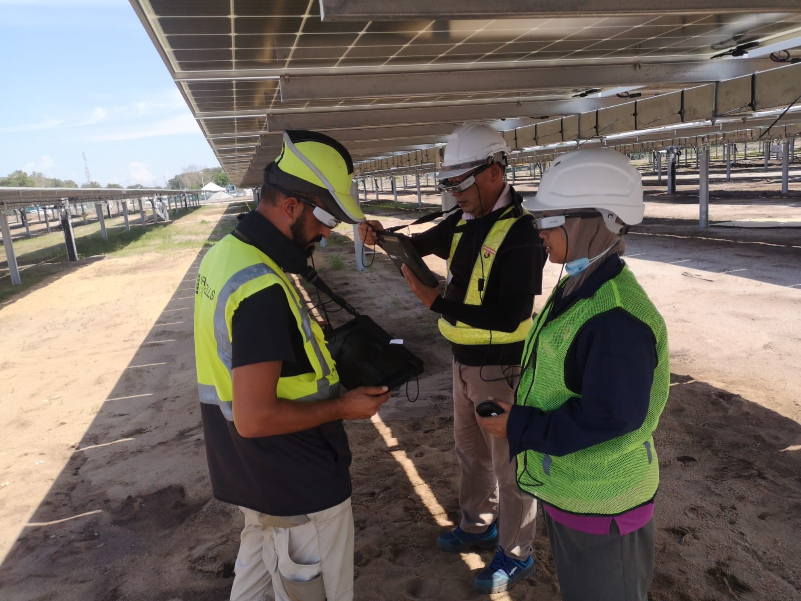 Greencells employees trialling AR technology at a recent site build. Image: Greencells.
