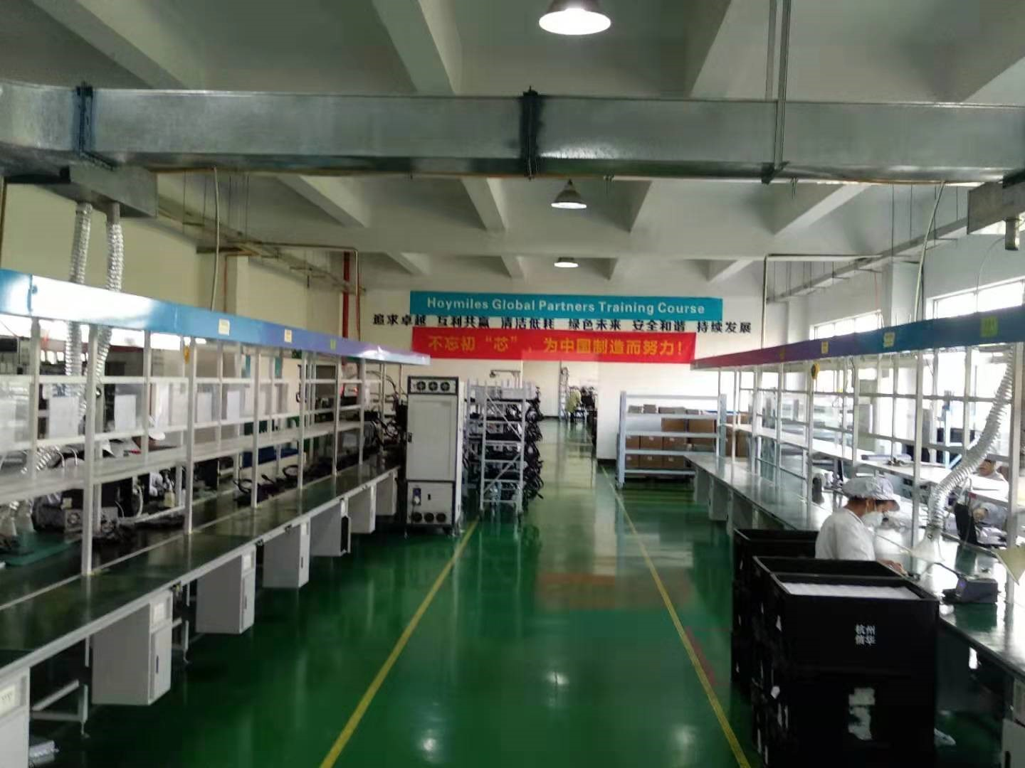 Among the products hitting factory shelves when PV Tech visited were MI-1200 units, marketed as the world's first single-phase microinverter able to service four panels at once (Image credit: Solar Media)