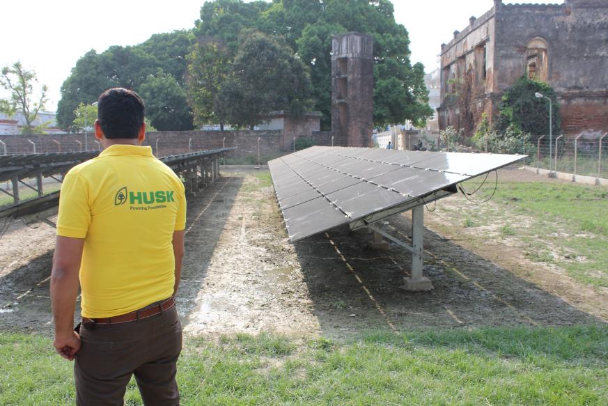Inspecting the hybrid mini-grid solar modules. Credit: Tom Kenning