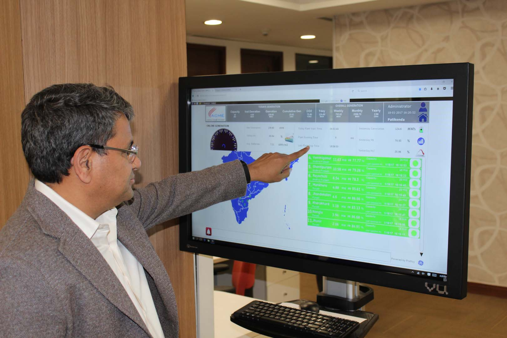 Upadhyay looks at analytics of a solar plant. Credit: Tom Kenning