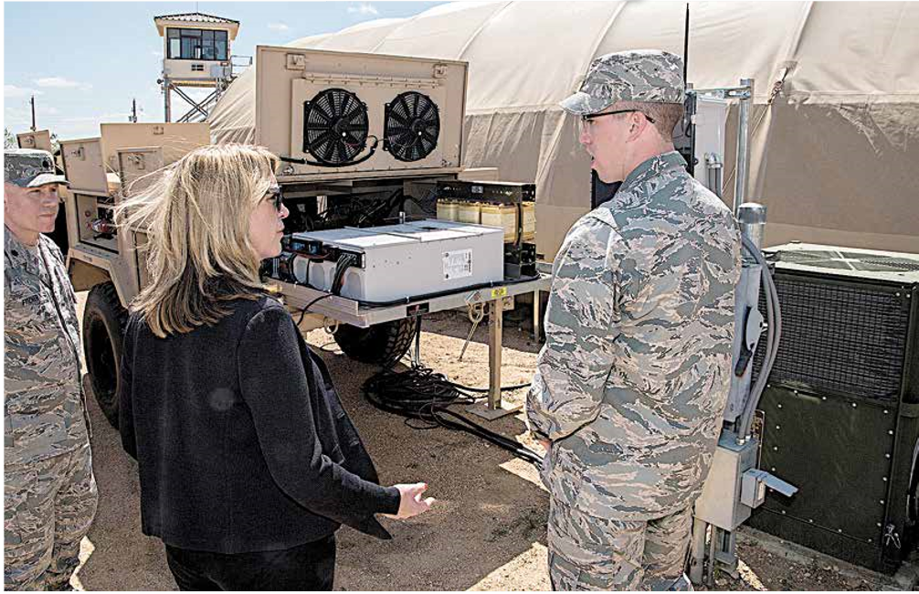 Secretary of the Air Force Deborah Lee James speaks with 1st Lt. Jonathan Goins, an environment research engineer at the Air Force Research Lab. Source: Johnny Salvidar