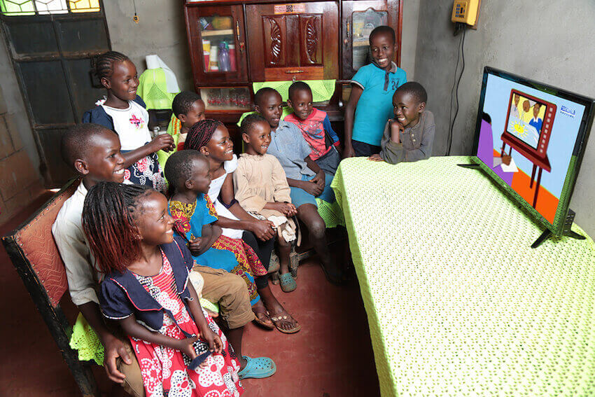 Off-grid solar could help keep lights on for children provided with up to eight hours of daily lessons through TV and radio. Image credit: Azuri Technologies