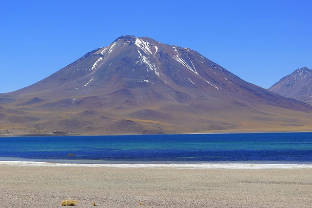 A volcano and lake near the San Pedro de Atacama in the Antofagasta region of Chile. Source: Flickr / Person with no name