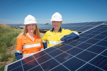 SA Water's procurement manager Nichola Murphy and chief exec Roch Cheroux inspect solar PV panels at a site in Glenelg, South Australia. Image: SA Water.