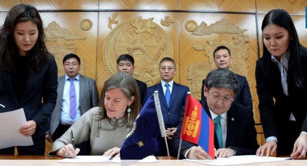 ADB Country Director for Mongolia Ms. Yolanda Fernandez Lommen (seated, left) with Minister of Finance Mr. Khurelbaatar Chimed (seated, right) during the signing of the projects to develop the country's first distributed renewable energy system and improve tax administration and public investment management using ICT. Credit: ADB