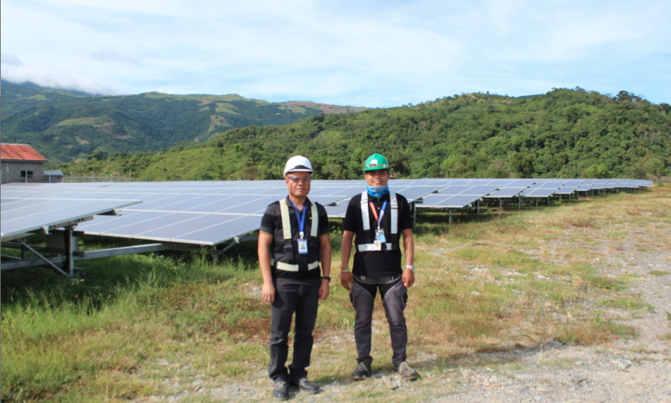O&M operators at Solar Philippines' solar-battery micro-grid in Palaun, Mindoro, using Tesla batteries, PV and diesel to supply 24/7 power in a remote, rural region.