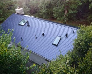 Despite some obvious shading issues from trees, Tesla has started installing its solar roof tile system in the US. Image: Tesla