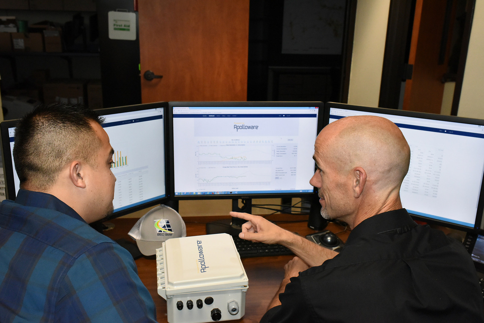 BEC Renewable Energy programme manager Miguel Rivera and database administrator Perry Holt test Apolloware. Source: PR Newswire