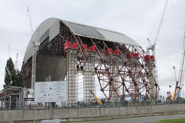 The New Safe Confinement, an immense steel arch being built to protect Chernobyl's crumbling sarcophagus and allow engineers to work safely on the gradual dismantling of the damaged reactor. The internationally-funded shelter is due to be wheeled over the reactor sometime in 2015.