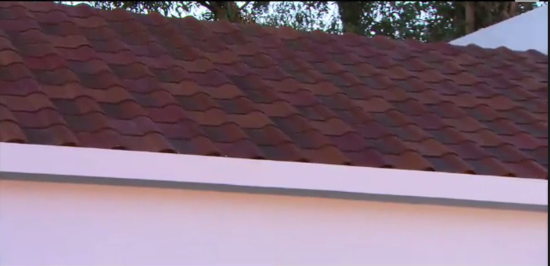 Dark shaded tiles are solar cells. Tesla/SolarCity