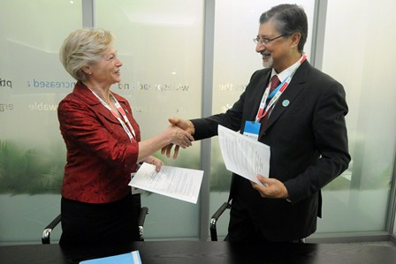 Adnan Amin, director general of IRENA meeting with Maria van der Hoeven, the former head of the IEA. Source: IRENA.