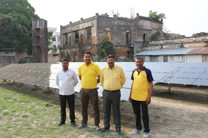 Husk Power Systems' team at its solar, energy storage and biomass mini-grid in Tamkuhi Raj, Uttar Pradesh, India. Credit: Tom Kenning