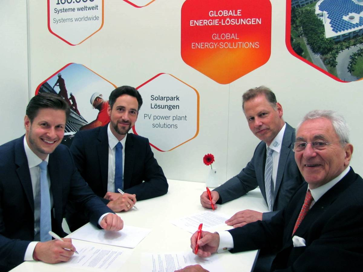 Representatives from IBC Solar and DHYBRID signing the cooperation agreement at Intersolar Europe last week. Source: IBC Solar