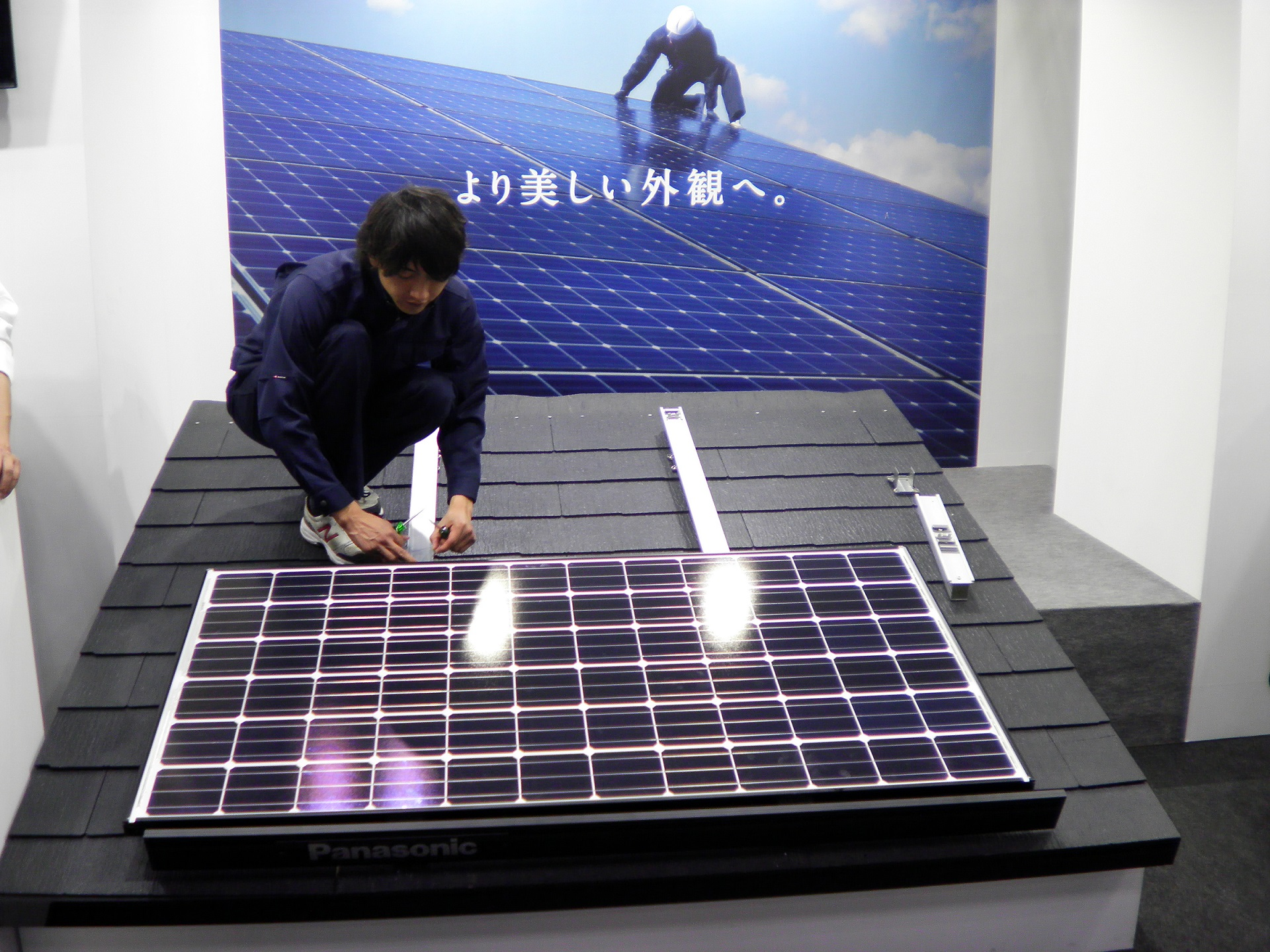 Cost reductions toward grid parity are likely to come from areas including streamlining installation processes. Shown here is a demonstration from Panasonic. Image: Andy Colthorpe.