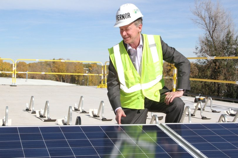Governor Hickenlooper installing solar panels at the 64kW array. Source: GRID Alternatives